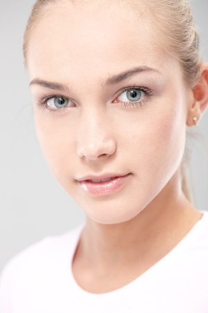clear skin: Closeup facial portrait of natural teenage beauty smiling at camera.