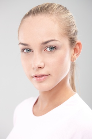 Closeup portrait of young pure face teenager looking at camera confidently. Stock Photo - 11157386