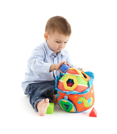 soft toy: Cute baby enjoying colorful developmental toy.