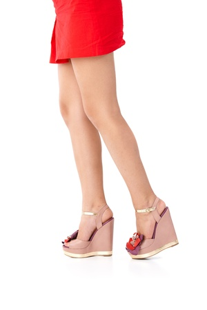 Pretty legs in red mini skirt and high heel sandals. photo