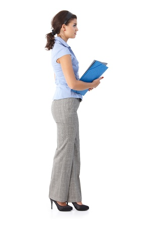 Young female office worker holding folders. photo