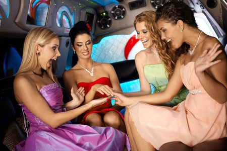 Hens night in limo with attractive young girls. photo