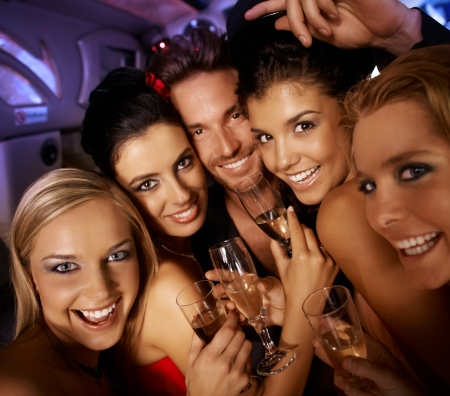 hen party: Young attractive people having party fun, drinking, laughing. Stock Photo