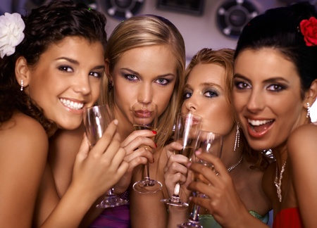 party dress: Beautiful hot girls having party fun, drinking champagne. Stock Photo