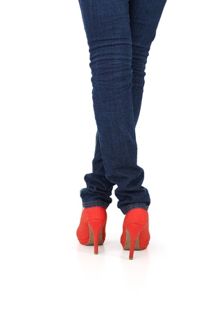 red shoes: Pretty female legs in jeans and red high heel shoes, back view, isolated on white.