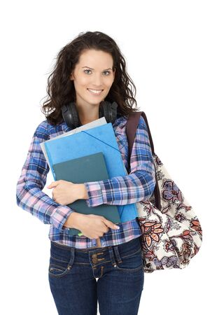 Portrait of happy college student girl with trendy handbag and books. photo