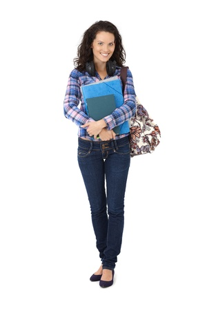 Confident smiling university student girl holding handbag and books and notes. photo
