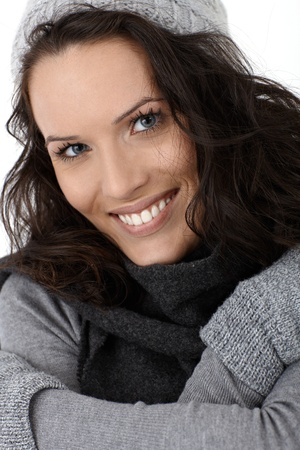 Closeup winter portrait of smiling beauty wearing scarf and gloves. Stock Photo - 12174654