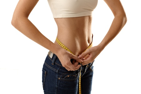 Thin woman measuring waistline size with tape measure. Stock Photo - 12174544