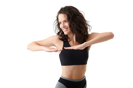 athletic wear: Sporty woman in sportswear doing exercise, smiling, cutout on white.