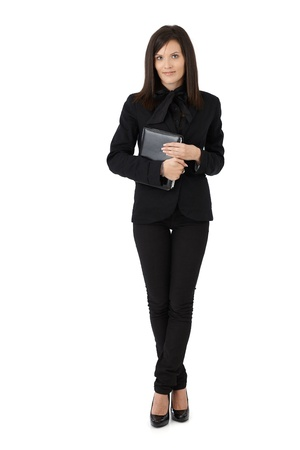 Young businesswoman portrait, holding personal organizer, full length picture isolated on white. photo