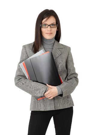 Portrait of smart businesswoman in glasses posing with file folders, isolated on white. photo