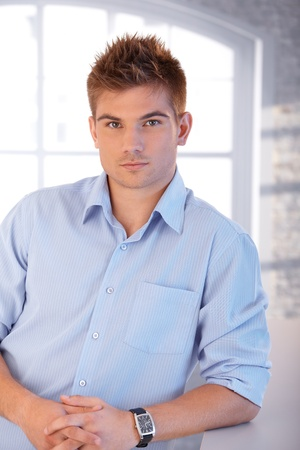 Portrait of young handsome man looking at camera. photo