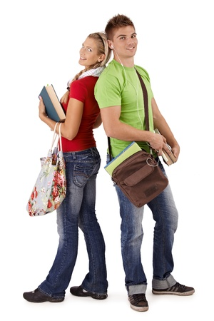 Happy trendy college students with bags and books, posing together, smiling at camera, cutout on white. photo