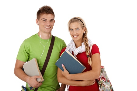 Portrait of trendy happy university students holding notes and books, smiling at camera. photo