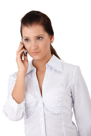 offish: Young woman talking on mobile phone. Stock Photo