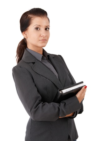 offish: Portrait of confident young businesswoman, looking at camera.