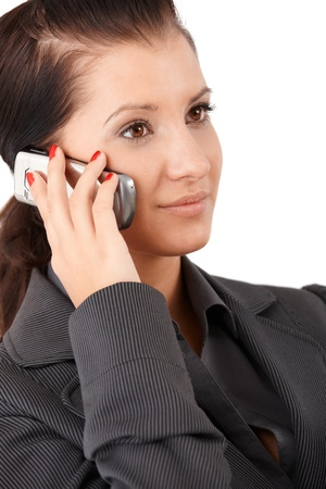 offish: Portrait of young businesswoman with mobile phone.