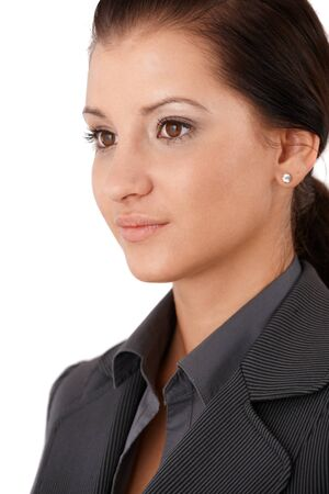 offish: Portrait of pretty young businesswoman, half side view. Stock Photo
