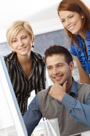 Portrait of happy business team at work, smiling. Stock Photo - 12471939