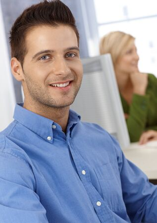 Portrait of smiling casual office worker man looking at camera. photo