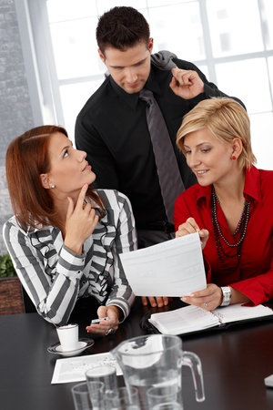 Smiling businesspeople at discussion of documents at meeting. Stock Photo - 12472022