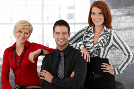 Happy smart businesspeople portrait, team posing together, smiling, looking at camera. Stock Photo - 12471871