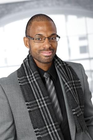 afroamerican: Portrait of elegant Afro-American businessman smiling, looking at camera.