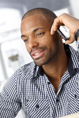 calling on phone: Closeup portrait of handsome Afro-American man on mobile phone call. Stock Photo
