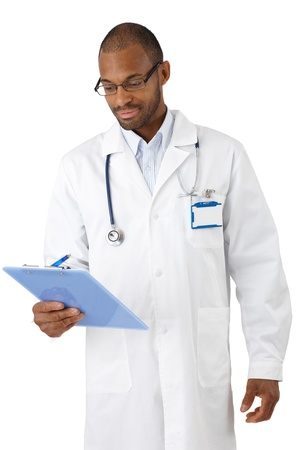 Young black doctor examining result on clipboard, smiling. photo