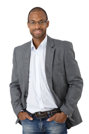 Portrait of confident Afro-American businessman smiling, cutout on white. photo