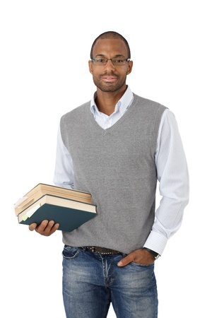 Portrait of smart black university student posing with books handheld, cutout on white. photo