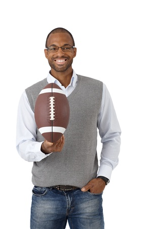 Portrait of happy guy laughing, posing with American football, isolated on white. photo