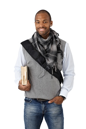 Portrait of stylish Afro-American university student smiling at camera, holding textbook, wearing scarf. photo