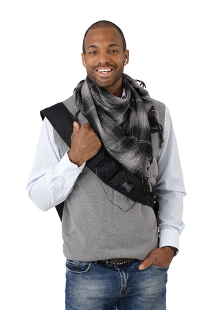 Laughing stylish ethnic guy with bag and scarf, isolated on white. photo