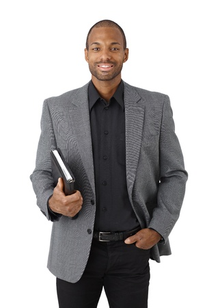 Portrait of smart black businessman smiling with personal organizer handheld, isolated on white. photo