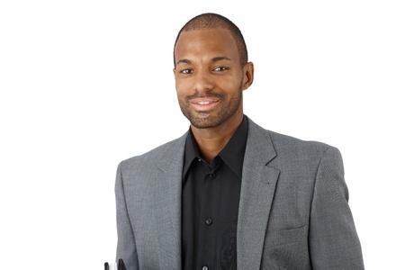 Portrait of happy confident black businessman in suit, smiling at camera. photo
