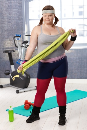 Overweight young woman prepared for workout at the gym. Stock Photo - 12472237