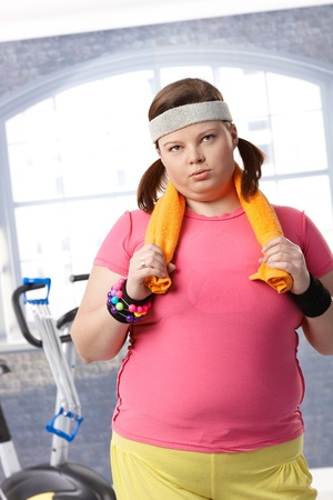 Exhausted fat woman after workout at the gym. photo