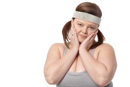 portrait of disappointed fat woman in sportswear. photo