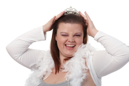 Portrait of young plump woman in tiara, winking, smiling. photo