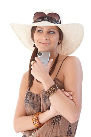 Happy woman smiling at holiday, holding camera. Stock Photo - 12652684