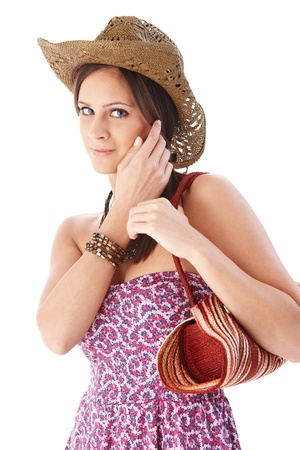 Pretty girl in straw hat and summer dress. photo
