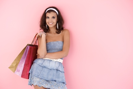 Attractive girl smiling with shopping bags at summertime. photo