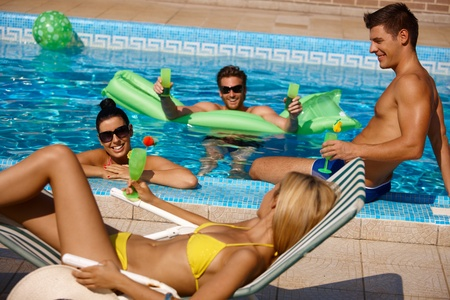 black man white woman: Young people having summer fun in outdoor pool. Stock Photo