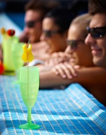 Young people in pool having cocktail at summertime. Stock Photo - 12918420