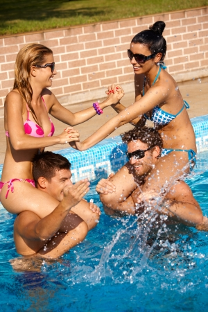 male friends: Happy young companionship having summer fun in swimming pool outdoor.