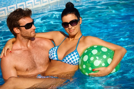 Attractive young couple having fun in swimming pool. Stock Photo - 12918707