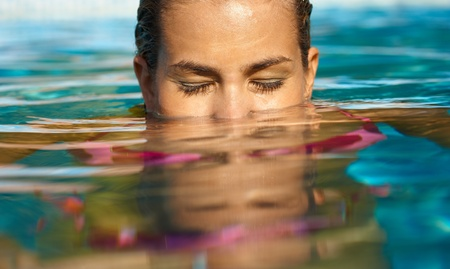 Young woman swimming eyes closed. photo