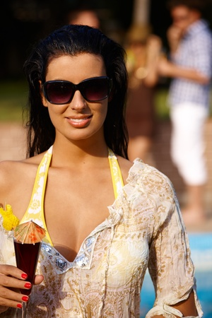 Summer portrait of attractive smiling girl with cocktail. photo